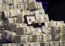 The 2011 WSOP Championship Bracelet is displayed along with bundles of cash during the World Se ...