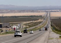 Traffic moves on Interstate 15 in California, seven miles south of Primm, near the Nipton Road ...