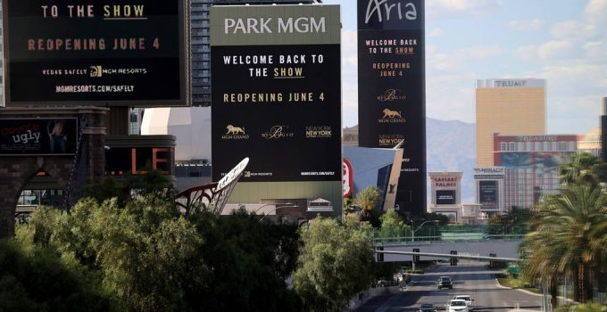 Marquees for MGM Resorts International properties on the Strip in Las Vegas, including from lef ...