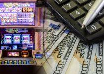 Mesin Slot Kasino Dengan Latar Belakang Pena Kalkulator Uang